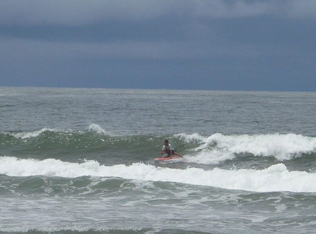 body board one boy in wave
